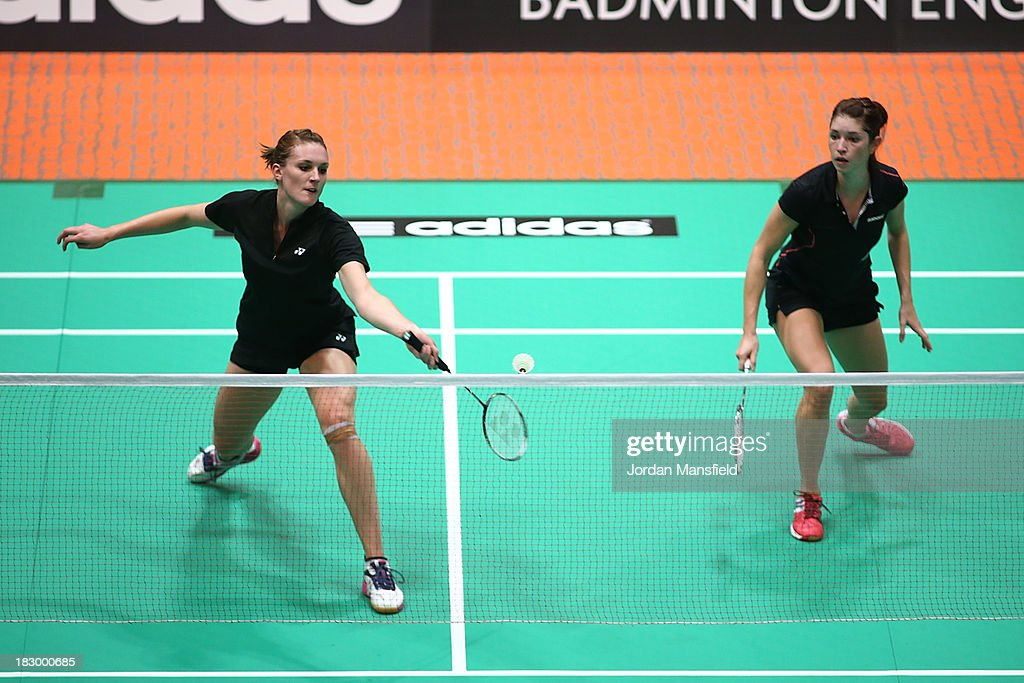 Kate Robertshaw (L) and Heather Oliver (R) of England in action in their womens doubles match against Porntip Buranaprasertsuk and Busanan Ongbumrungpan of Thailand during Day 3 of the London Badminton Grand Prix at The Copper Box on October 3, 2013 in London, England.