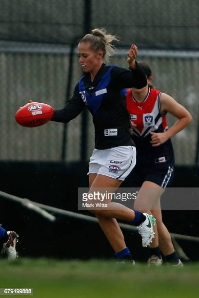 Kate Shierlaw of Melbourne Uni kicks the ball during the round one VFL Women's match between the Darebin Falcons and Melbourne Uni at Bill Lawry on...