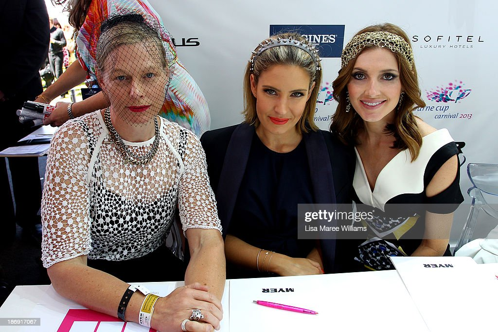 , Kate Sylvester, Elle Halliwelll and Kate Waterhouse look on during judging of Fashions on the Field during Melbourne Cup Day at Flemington Racecourse on November 5, 2013 in Melbourne, Australia.
