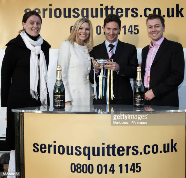 Kate Thornton centre left presents the SERIOUSQUITTERScouk Rockfel Stakes trophy to Paul Smith centre right representing Mrs David Nagle Mrs John...