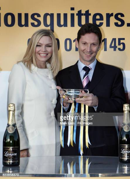 Kate Thornton presents the SERIOUSQUITTERScouk Rockfel Stakes trophy to Paul Smith representing Mrs David Nagle Mrs John Magnier the owners of...