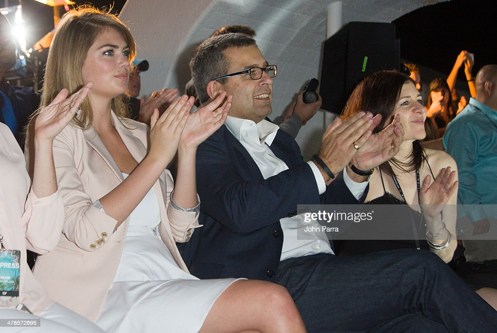 Kate Upton and David Kornberg attend the EXPRESS South Beach Runway Show at The Raleigh Hotel on March 13, 2014 in Miami, Florida.