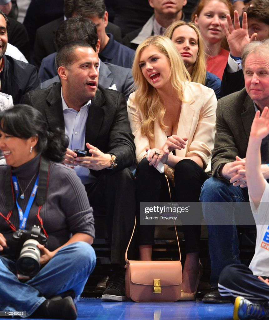 <a gi-track='captionPersonalityLinkClicked' href=/galleries/search?phrase=Kate+Upton&family=editorial&specificpeople=7488546 ng-click='$event.stopPropagation()'>Kate Upton</a> and David Spencer attend the Orlando Magic vs New York Knicks game at Madison Square Garden on March 28, 2012 in New York City.