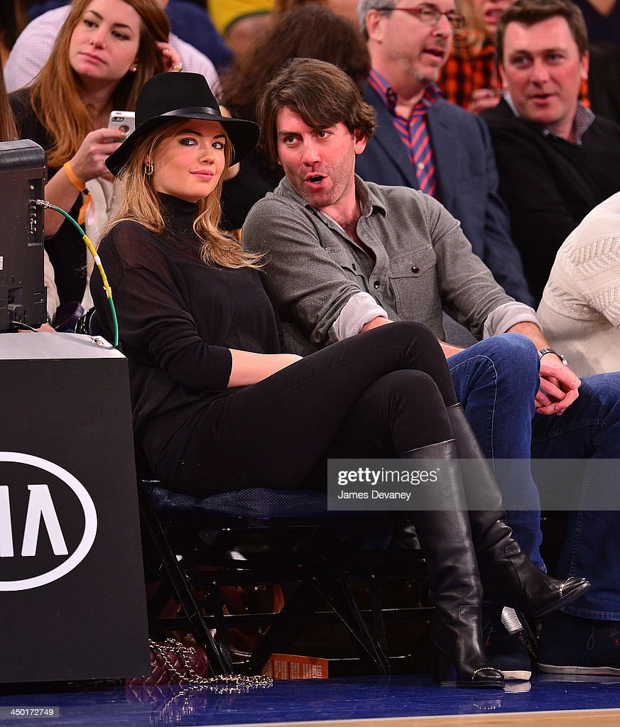 Kate Upton and guest attend the Atlanta Hawks vs New York Knicks game at Madison Square Garden on November 16, 2013 in New York City.