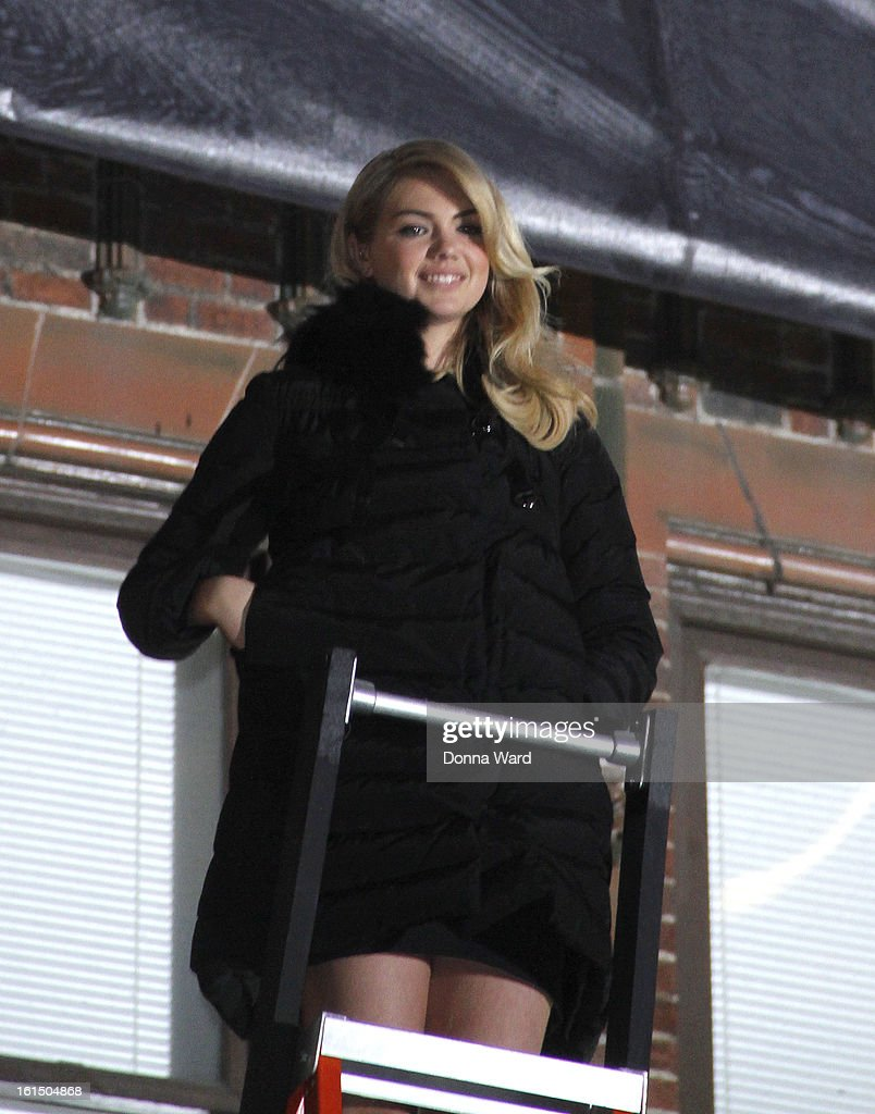Kate Upton appears on the marquee to unveil her Sports Illustrated Swimsuit Issue cover at 'The Late Show with David Letterman' at Ed Sullivan Theater on February 11, 2013 in New York City.