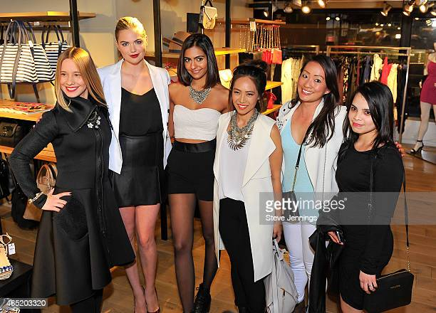 Kate Upton poses with fans at the EXPRESS Spring Fling Event with Kate Upton at Union Square on March 3 2015 in San Francisco California