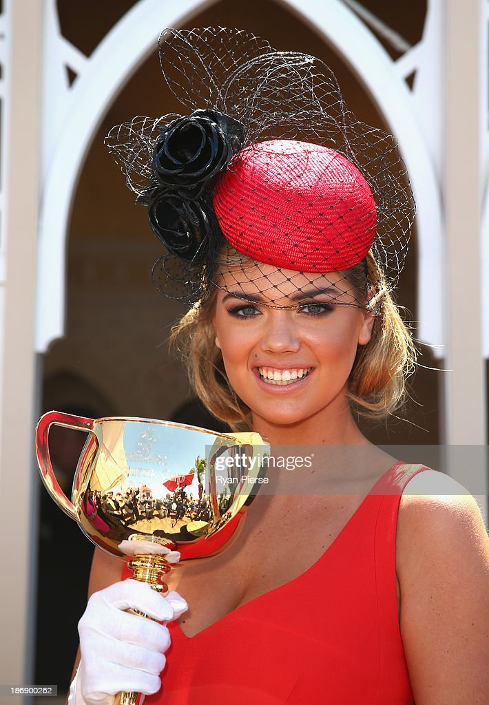 Kate Upton poses with the Melbourne Cup during Melbourne Cup Day at Flemington Racecourse on November 5, 2013 in Melbourne, Australia.