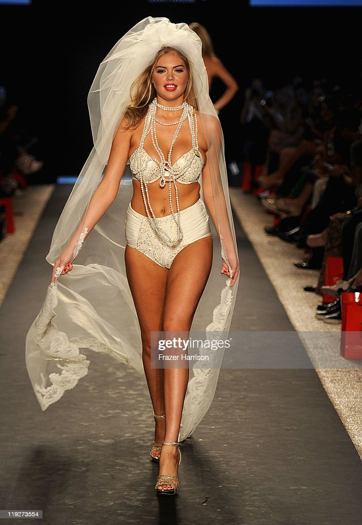 <a gi-track='captionPersonalityLinkClicked' href=/galleries/search?phrase=Kate+Upton&family=editorial&specificpeople=7488546 ng-click='$event.stopPropagation()'>Kate Upton</a> walks the runway at the Beach Bunny Swimwear show during Merecdes-Benz Fashion Week Swim 2012 at The Raleigh on July 15, 2011 in Miami Beach, Florida.