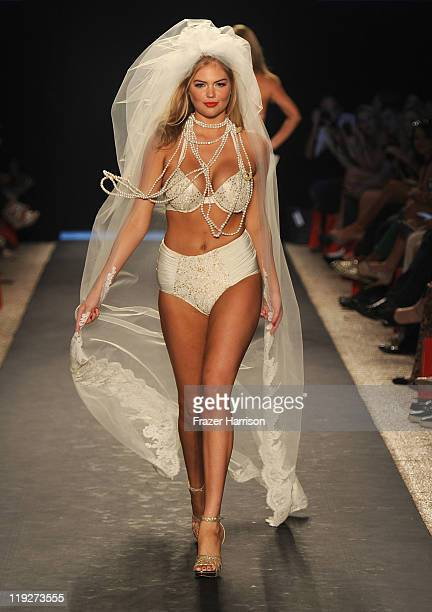 Kate Upton walks the runway at the Beach Bunny Swimwear show during MerecdesBenz Fashion Week Swim 2012 at The Raleigh on July 15 2011 in Miami Beach...