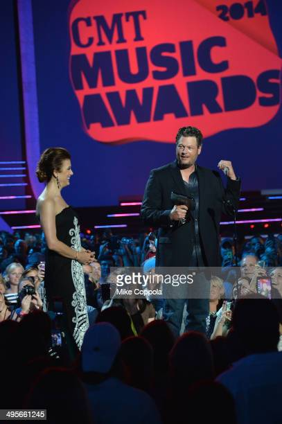 Kate Walsh and Blake Shelton speak onstage during the 2014 CMT Music awards at the Bridgestone Arena on June 4 2014 in Nashville Tennessee