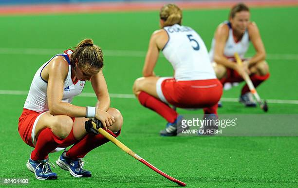 Kate Walsh Crista Cullen and Sarah Thomas of Great Britains react at the end of the 2008 Beijing Olympic Games preliminary women's field hockey match...