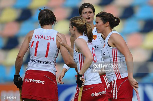 Kate Walsh of England celebrates with team mates after scoring their team's third goal during the Women´s EuroHockey Championships 2011 Pool B match...
