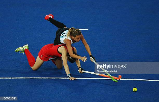 Kate Walsh of Great Britain and Delfina Merino of Argentina challenge for the ball during the Women's Hockey semifinal match between Argentina and...
