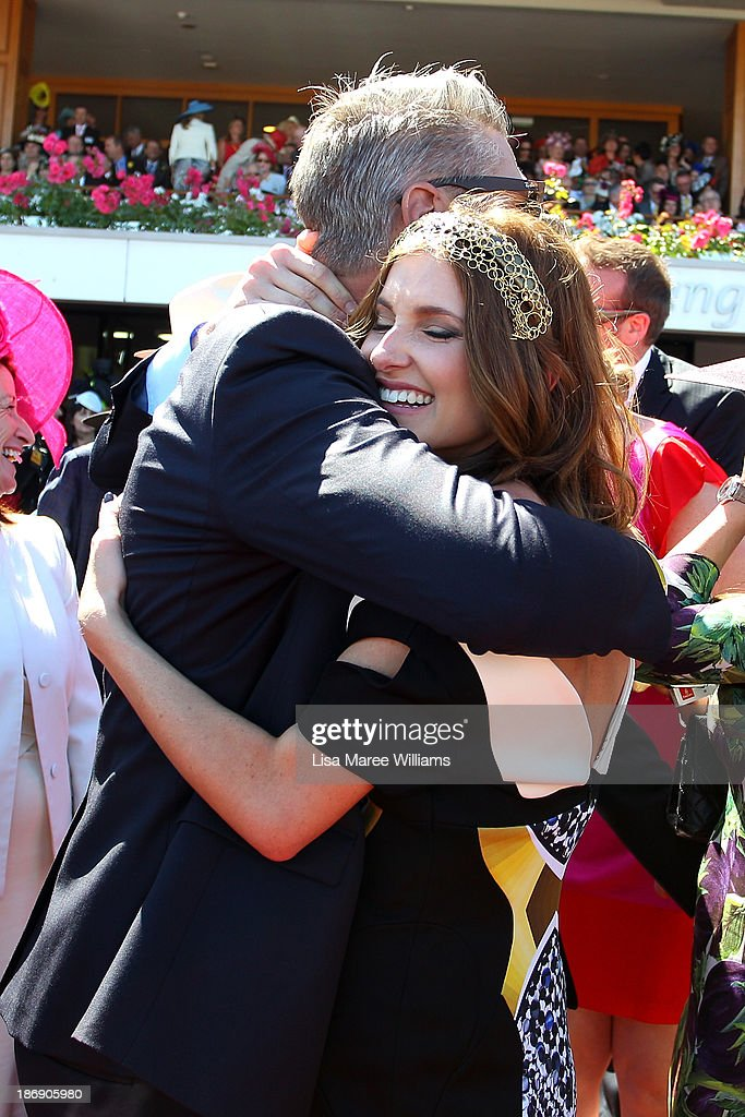 Kate Waterhouse and Luke Ricketson celebrate as the Gai Waterhouse trained horse Fiorente wins the Melbourne Cup during Melbourne Cup Day at Flemington Racecourse on November 5, 2013 in Melbourne, Australia.