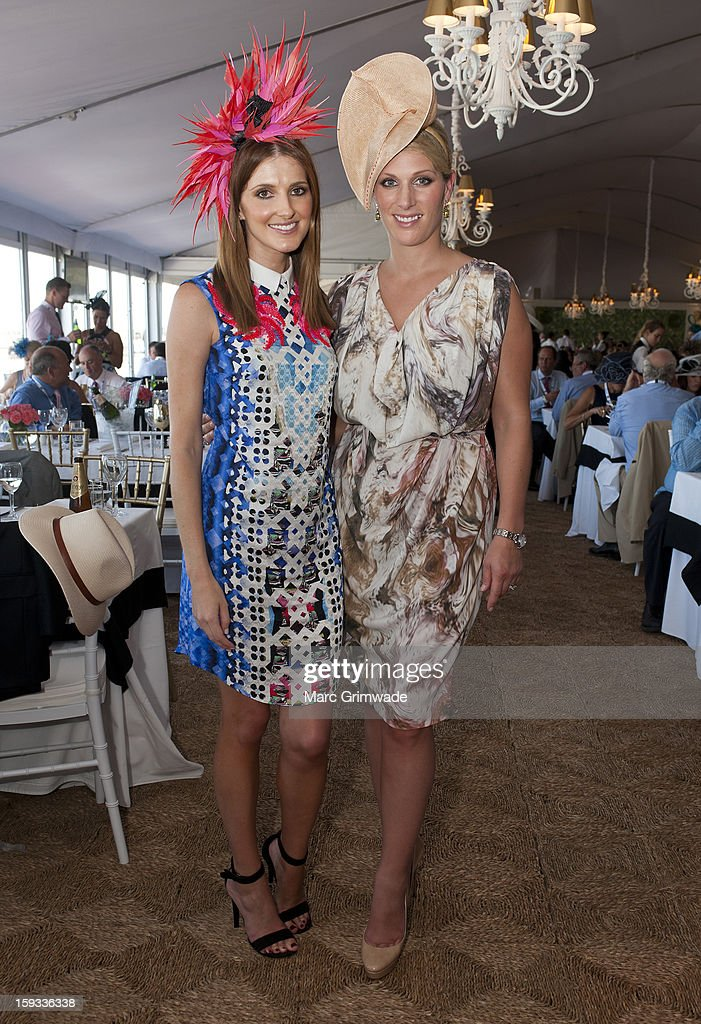 Kate Waterhouse and Zara Phillips pose in the Moet & Chandon marquee on Magic Millions Raceday at the Gold Coast Turf Club on January 12, 2013 in Gold Coast, Australia.