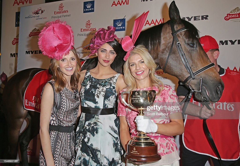 Kate Waterhouse, Samantha Downie and Alison Saville pose with the Melbourne Cup during the The 2012 Melbourne Cup Carnival Launch at Crown Palladium on October 29, 2012 in Melbourne, Australia.