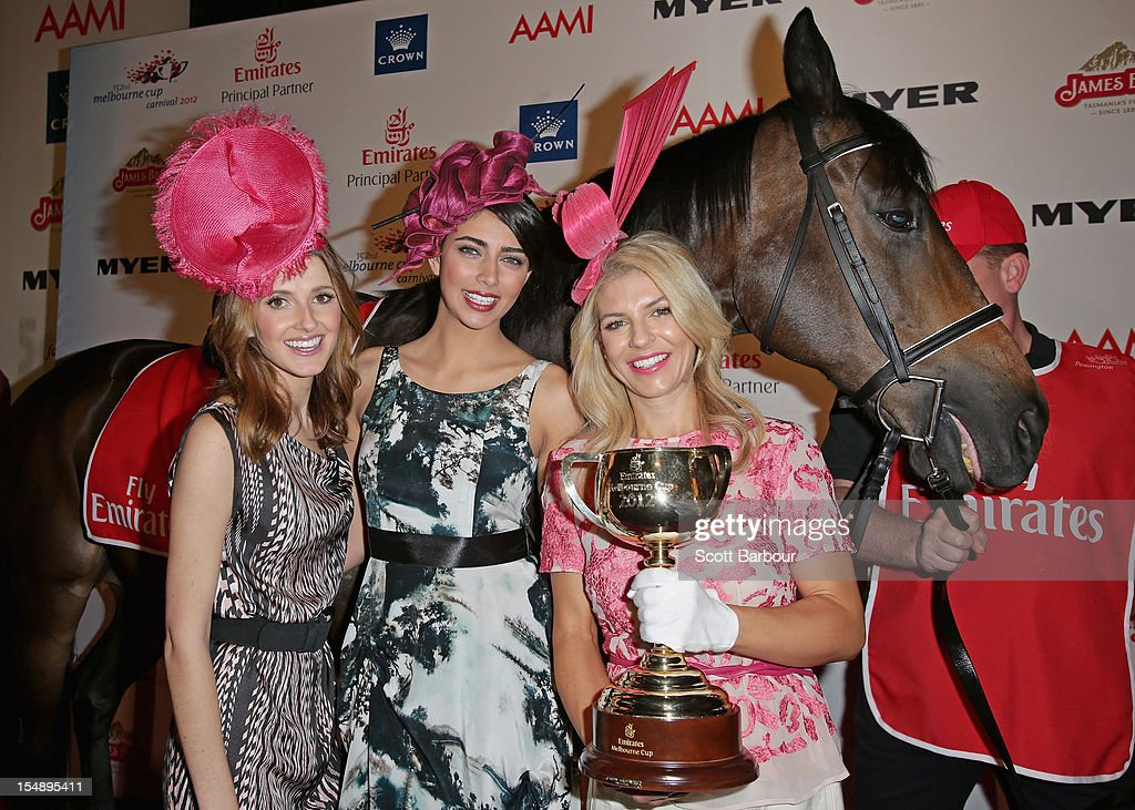 <a gi-track='captionPersonalityLinkClicked' href=/galleries/search?phrase=Kate+Waterhouse&family=editorial&specificpeople=208104 ng-click='$event.stopPropagation()'>Kate Waterhouse</a>, Samantha Downie and Alison Saville pose with the Melbourne Cup during the The 2012 Melbourne Cup Carnival Launch at Crown Palladium on October 29, 2012 in Melbourne, Australia.