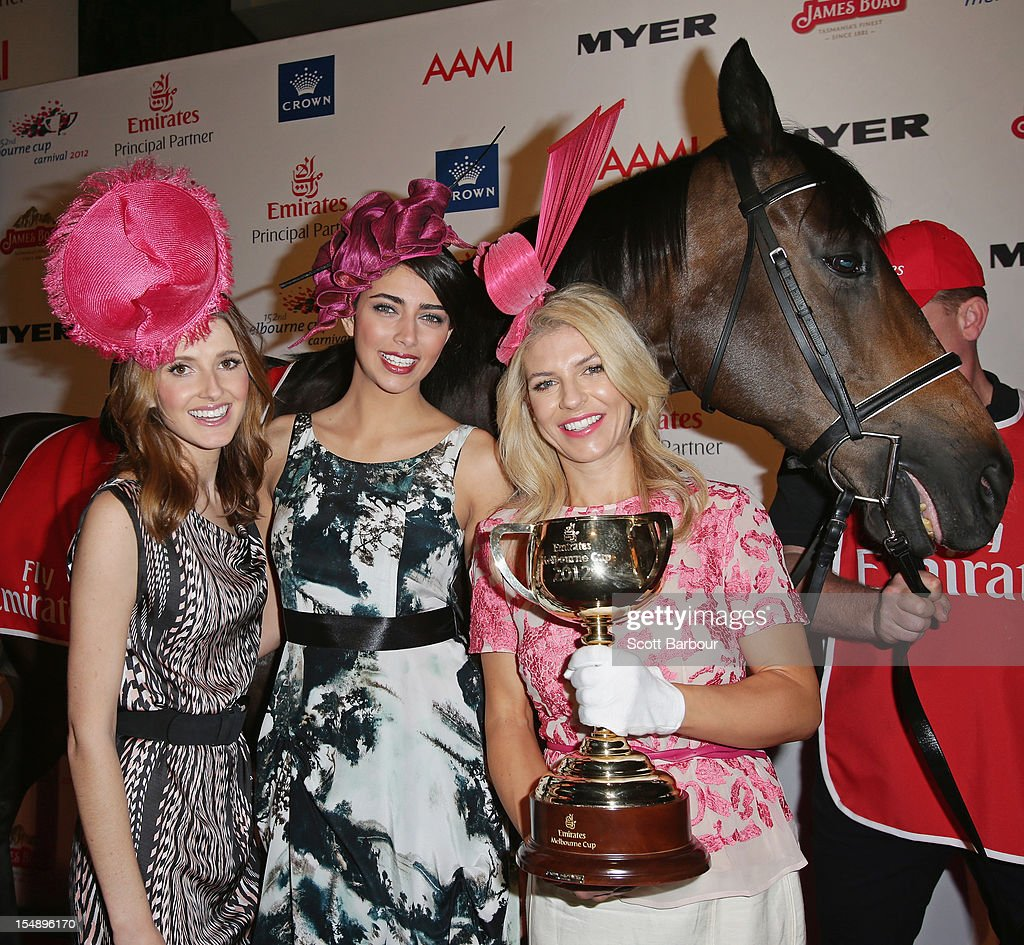 <a gi-track='captionPersonalityLinkClicked' href=/galleries/search?phrase=Kate+Waterhouse&family=editorial&specificpeople=208104 ng-click='$event.stopPropagation()'>Kate Waterhouse</a>, Samantha Downie, the Face of the Schweppes Flemington Fling and Alison Saville, the Myer Fashions on the Field Ambassador pose with the Melbourne Cup during the The 2012 Melbourne Cup Carnival Launch at Crown Palladium on October 29, 2012 in Melbourne, Australia.