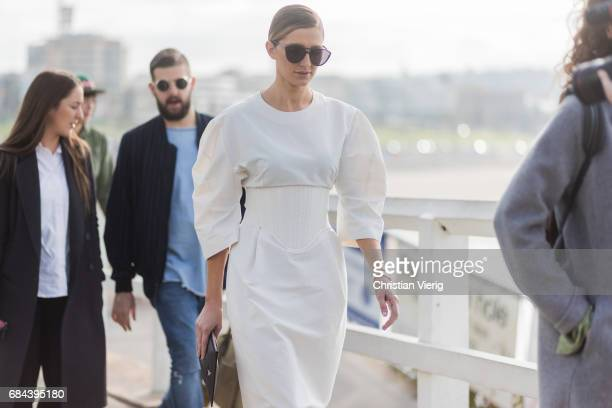 Kate Waterhouse wearing a white dress outside Ten Pieces at day 5 during MercedesBenz Fashion Week Resort 18 Collections at Icebergs on May 18 2017...