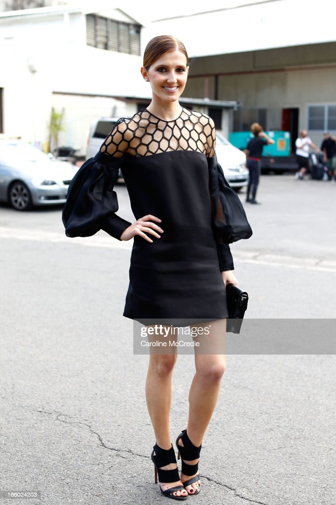 <a gi-track='captionPersonalityLinkClicked' href=/galleries/search?phrase=Kate+Waterhouse&family=editorial&specificpeople=208104 ng-click='$event.stopPropagation()'>Kate Waterhouse</a> wears a dress by Gucci at Mercedes-Benz Fashion Week Australia Spring/Summer 2013/14 at Carriageworks on April 8, 2013 in Sydney, Australia.