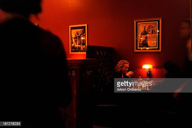 Kate Willink and Darrin Hicks chat in a booth at Williams Graham a recentlyopened speakeasy in the Highlands on Tuesday January 10 2012 AAron...