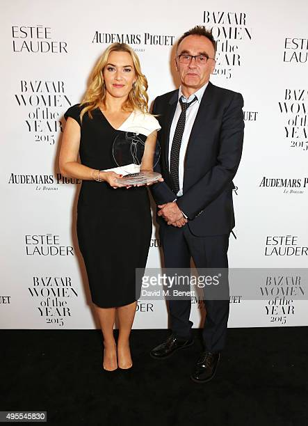 Kate Winslet and Danny Boyle attend the Harper's Bazaar Women of the Year Awards 2015 at Claridges Hotel on November 3 2015 in London England