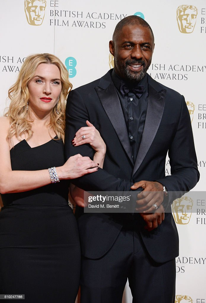Kate Winslet (L) and Idris Elba pose in the winners room at the EE British Academy Film Awards at The Royal Opera House on February 14, 2016 in London, England.