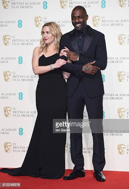 Kate Winslet and Idris Elba pose in the winners room at the EE British Academy Film Awards at the Royal Opera House on February 14 2016 in London...