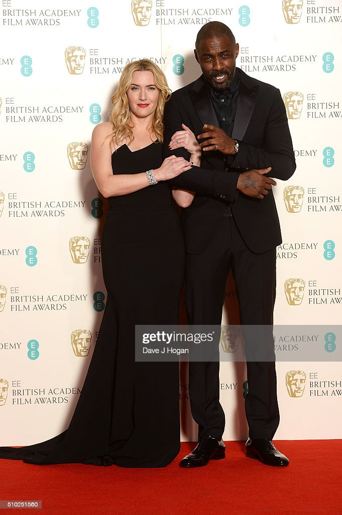 <a gi-track='captionPersonalityLinkClicked' href=/galleries/search?phrase=Kate+Winslet&family=editorial&specificpeople=201923 ng-click='$event.stopPropagation()'>Kate Winslet</a> (L) and <a gi-track='captionPersonalityLinkClicked' href=/galleries/search?phrase=Idris+Elba&family=editorial&specificpeople=215443 ng-click='$event.stopPropagation()'>Idris Elba</a> pose in the winners room at the EE British Academy Film Awards at The Royal Opera House on February 14, 2016 in London, England.