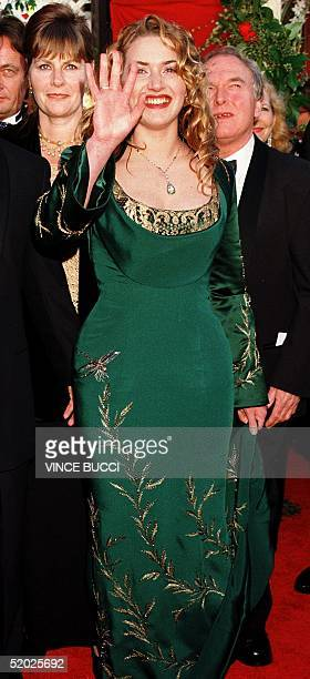 Kate Winslet Best Actress nominee for her role in 'Titanic' arrives at the 70th Annual Academy Awards ceremony 23 March at the Shrine Auditorium in...