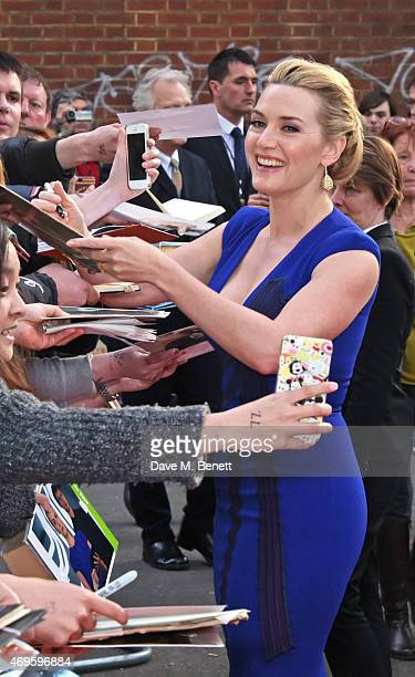 Kate Winslet signs autographs at the UK premiere of 'A Little Chaos' at ODEON Kensington on April 13 2015 in London England