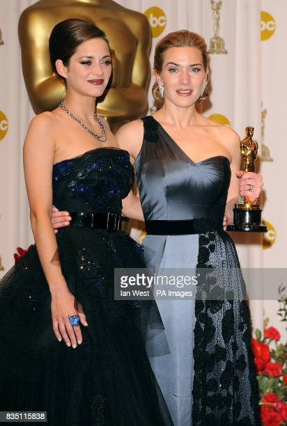 Kate Winslet with the Performance by an Actress in a Leading Role award received for The Reader and Marion Cotillard at the 81st Academy Awards at...