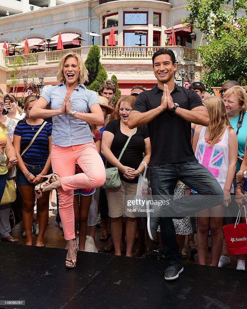 Katee Sackoff (L) and <a gi-track='captionPersonalityLinkClicked' href=/galleries/search?phrase=Mario+Lopez&family=editorial&specificpeople=235992 ng-click='$event.stopPropagation()'>Mario Lopez</a> visit 'Extra' at The Grove on July 25, 2012 in Los Angeles, California.