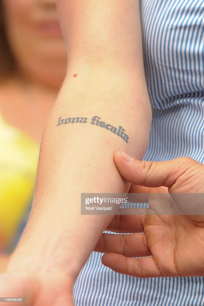 Katee Sackoff displays her tattoos at 'Extra' at The Grove on July 25, 2012 in Los Angeles, California.