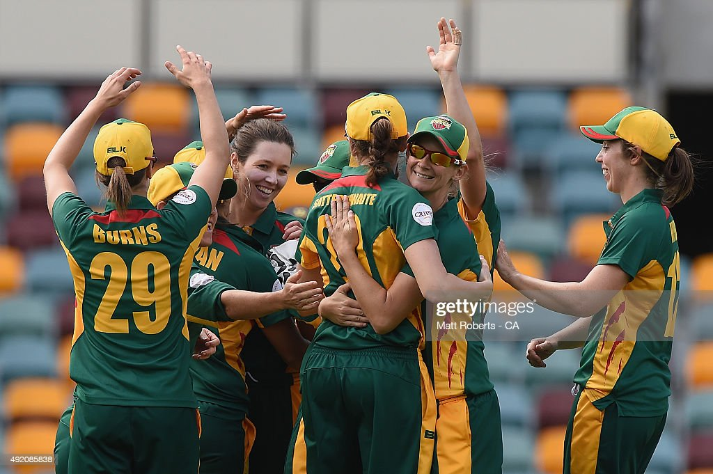 Katelyn Fryett of the Roar celebrates with team mates the wicket of Meg Lanning of the Spirit during the round one WNCL match between Victoria and...