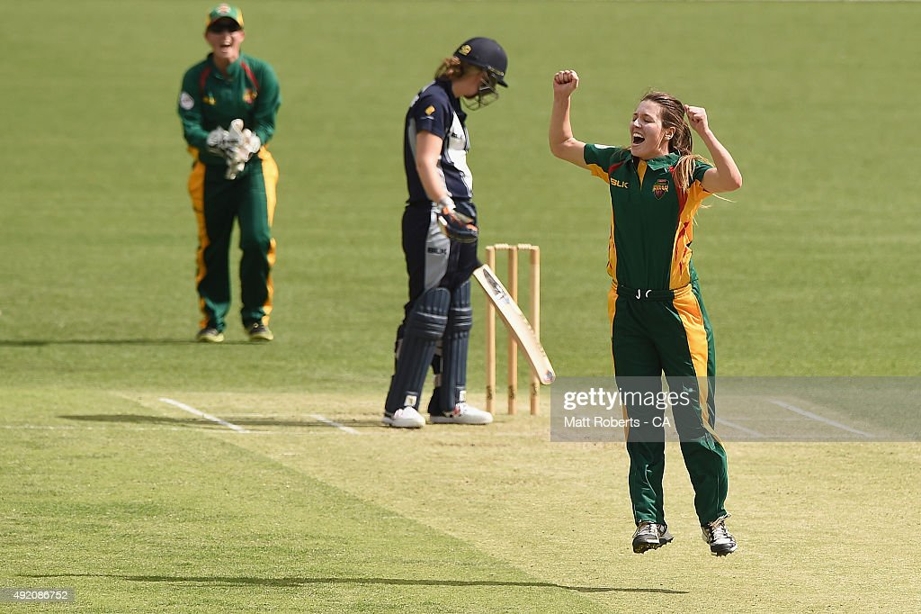 Katelyn Fryett of the Roar celebrates with team mates the wicket of Anna Lanning of the Spirit during the round one WNCL match between Victoria and...