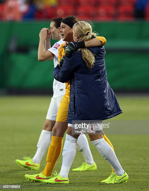 Katelyn Rowland of the United States is consoled after losing to Korea DPR in a shootout during the FIFA U20 Women's World Cup Canada 2014 Quarter...