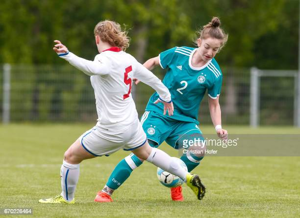 Katerina Marcinkova of Czech Republic challenges Nina Schumacher of Germany for the ball during the Under 15 girls international friendly match...