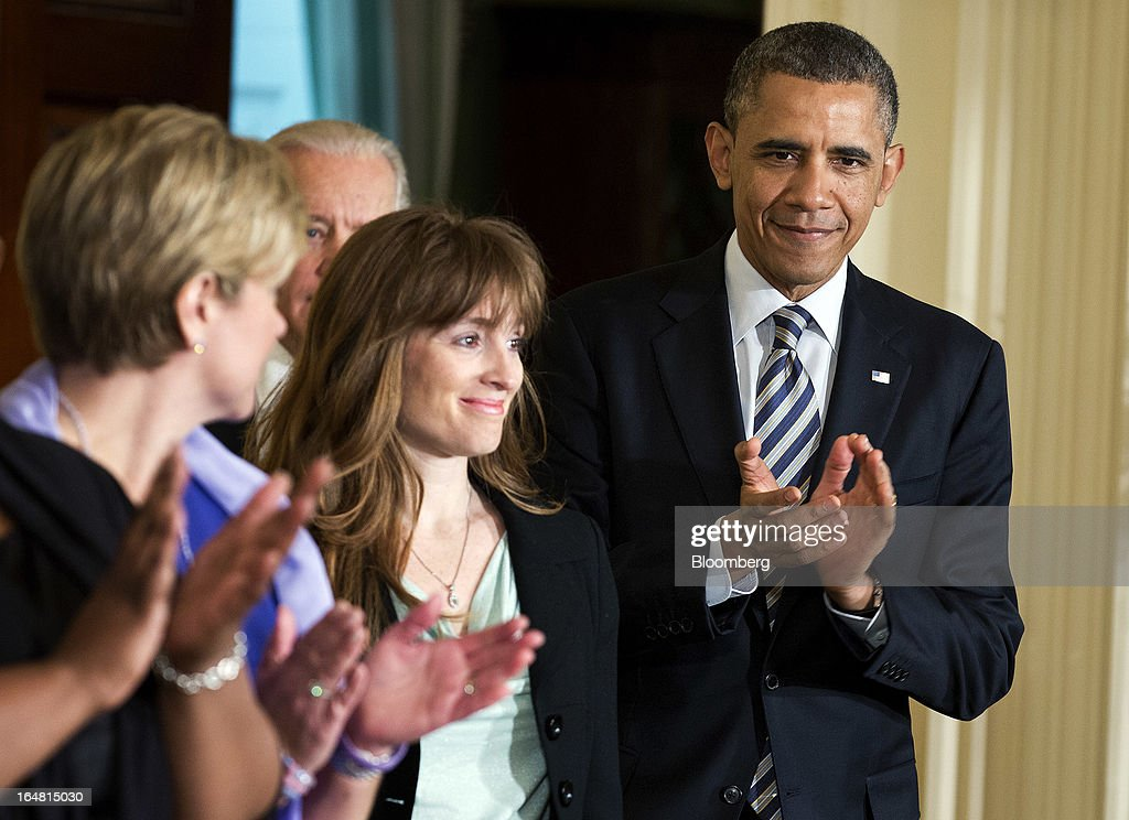 Katerina Rodgaard of Moms Demand Action for Gun Sense in America, center, prepares to introduce U.S. President <a gi-track='captionPersonalityLinkClicked' href=/galleries/search?phrase=Barack+Obama&family=editorial&specificpeople=203260 ng-click='$event.stopPropagation()'>Barack Obama</a> during an event in the East Room of the White House in Washington, D.C., U.S., on Thursday, March 28, 2013. Obama, with families of victims of the Connecticut school shooting tragedy at his side, pressed the Senate to pass gun-control legislation next month and urged lawmakers to resist any weakening of resolve. Photographer: Joshua Roberts/Bloomberg via Getty Images