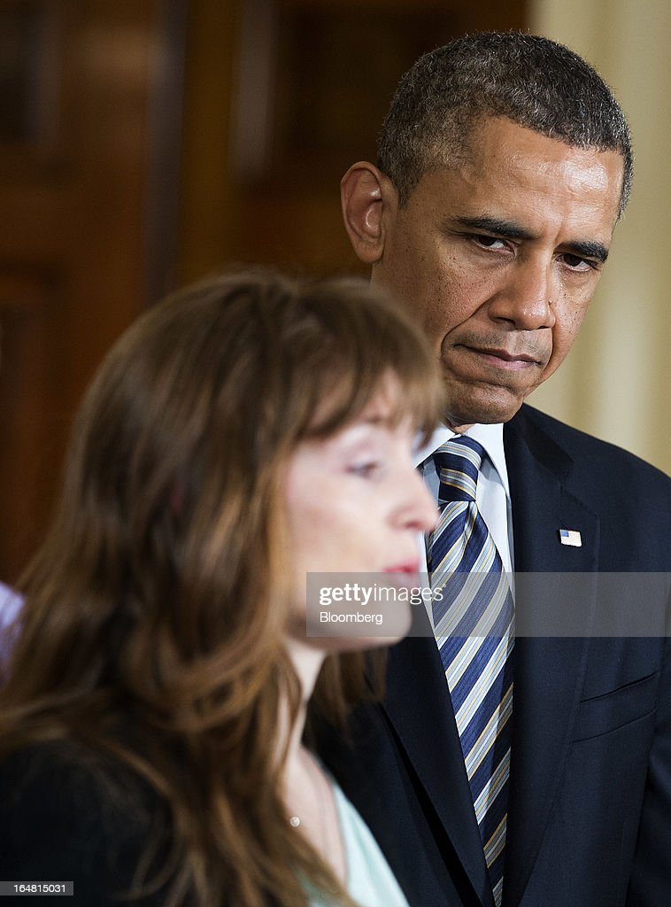 Katerina Rodgaard of Moms Demand Action for Gun Sense in America introduces U.S. President <a gi-track='captionPersonalityLinkClicked' href=/galleries/search?phrase=Barack+Obama&family=editorial&specificpeople=203260 ng-click='$event.stopPropagation()'>Barack Obama</a> during an event in the East Room of the White House in Washington, D.C., U.S., on Thursday, March 28, 2013. Obama, with families of victims of the Connecticut school shooting tragedy at his side, pressed the Senate to pass gun-control legislation next month and urged lawmakers to resist any weakening of resolve. Photographer: Joshua Roberts/Bloomberg via Getty Images