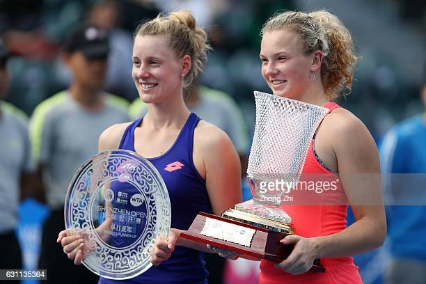 Katerina Siniakova of Czech Republic and Alison Riske of United States pose for photo with their trophy after the singles final match against during...