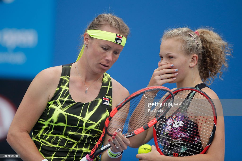 Katerina Siniakova of Czech Republic and Vera Dushevina of Russia talk tactics in their first round match against Timea Babos of Hungary and Katarina...