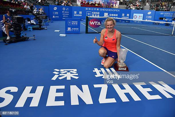 Katerina Siniakova of Czech Republic celebrates with champion trophy after winning the singles final match against Alison Riske of United States...