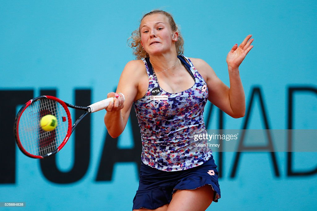 Katerina Siniakova of Czech Republic in action against Ana Ivanovic of Serbia during day two of the Mutua Madrid Open tennis tournament at the Caja Magica on May 01, 2016 in Madrid, Spain.