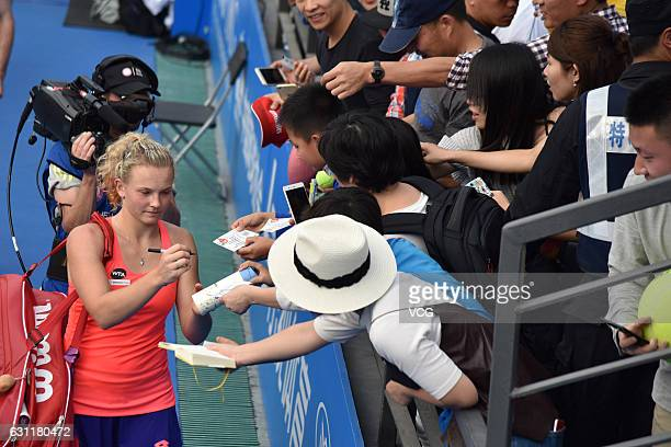 Katerina Siniakova of Czech Republic signs name for fans after winning the singles final match against Alison Riske of United States during Day 7 of...