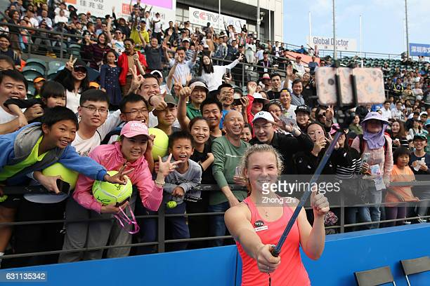 Katerina Siniakova of Czech Republic takes selfie with fans after winning the singles final match against Alison Riske of United States during Day 7...