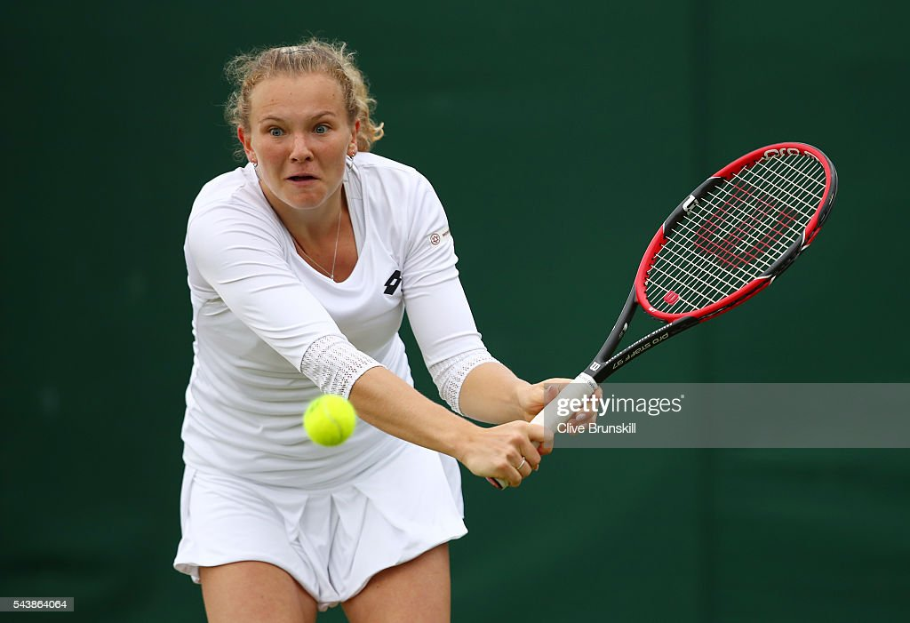 Katerina Siniakova of The Czech Republic plays a backhand during the Ladies Singles second round match against Caroline Garcia of France on day four of the Wimbledon Lawn Tennis Championships at the All England Lawn Tennis and Croquet Club on June 30, 2016 in London, England.