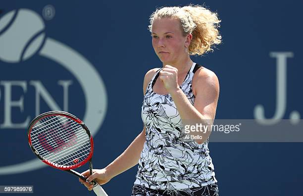 Katerina Siniakova of the Czech Republic reacts against Eugenie Bouchard of Canada during her first round Women's Singles match on Day Two of the...
