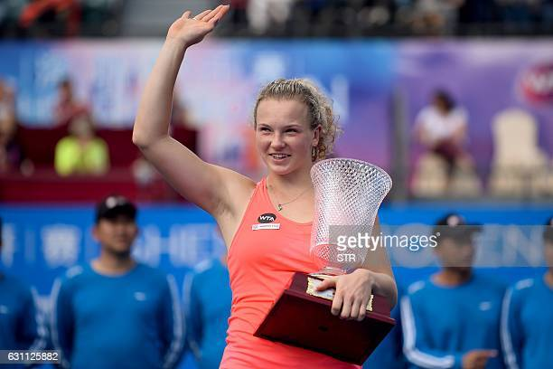 Katerina Siniakova of the Czech Republic waves to the audience after winning the women's singles final match against Alison Riske of the US at the...