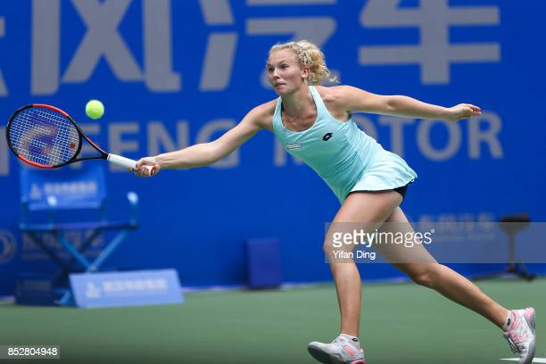 Katerina Siniakova plays a forehand during the match against Kristina Mladenovic on Day 1 of 2017 Dongfeng Motor Wuhan Open at Optics Valley...